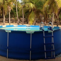 Photo taken at Playa de Boca de Uchire by Aracelis M. on 5/11/2013