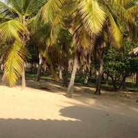Photo taken at Playa de Boca de Uchire by Aracelis M. on 6/24/2013