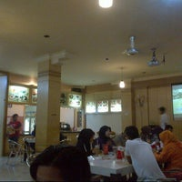 Photo taken at Milo Cafe by Adhy P. on 4/15/2013