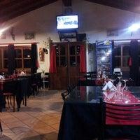 Photo taken at Parrilla Restaurant el Gringo by Juan Ignacio G. on 3/9/2013