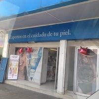 Photo taken at Farmacia Dermatológica by Alexis V. on 5/14/2014