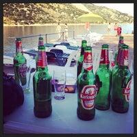 Photo taken at Plaža hotela Velinac by Igor R. on 7/12/2014