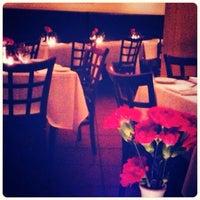 Photo taken at Luce Restaurant & Enoteca by Niña D. on 2/27/2014