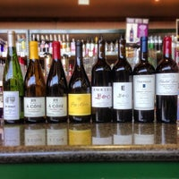 Photo taken at Green Jug Fine Wine & Spirits by Green Jug on 3/22/2013