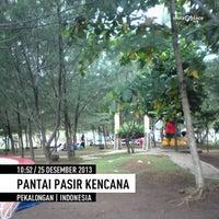 Photo taken at Pantai Pasir Kencana by Adrianus D. on 12/25/2013