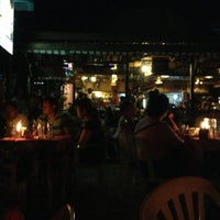 Photo taken at Seaslug's Beach Bar And Resto by Jomer O. on 4/22/2013