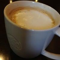 Photo taken at Starbucks by Yusuke F. on 4/8/2013