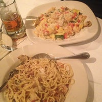 Photo taken at Carino's Italian Restaurant by Jose A. on 6/14/2013