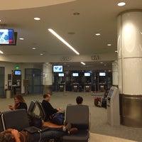 Photo taken at Gate 69B by Oscar S. on 9/30/2013