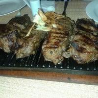 Photo taken at Restaurant La Rueda 1975 by Bruno M. on 2/11/2013