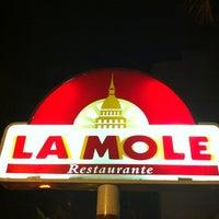 Photo taken at La Mole by Mariana M. on 1/25/2013