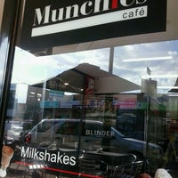 Photo taken at Munchies Cafe by Chris G. on 3/6/2013