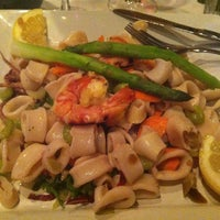 Photo taken at Topo Gigio Ristorante by Jodi E. on 7/17/2013