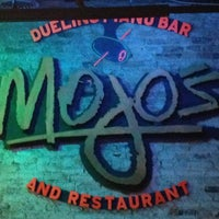 Photo taken at Mojo's Dueling Piano Bar by Alice K. on 2/14/2013