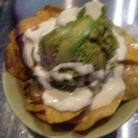 Photo taken at Tuzo Mexican Kitchen by Anna O. on 6/22/2015