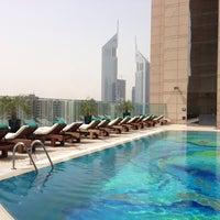 Photo taken at Fairmont Dubai by Bilal M. on 5/23/2013