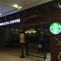 Photo taken at Starbucks by Apinya B. on 7/17/2018