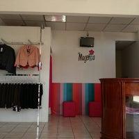 Photo taken at Magenta Boutique by Lionela L. on 3/16/2013