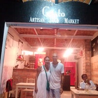 Photo taken at GUSTO Artisan Food Market by Edson R. on 7/31/2014