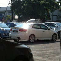 Photo taken at Naza KIA Services Sdn. Bhd. by alish a. on 5/24/2014
