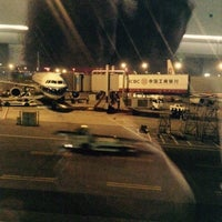 Photo taken at Gate 73 by Mariia S. on 1/1/2015
