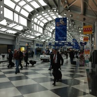Photo taken at Concourse C by Michael L. on 12/19/2012