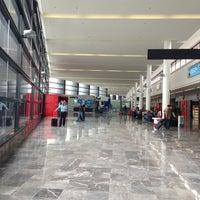 Photo taken at Aeropuerto Internacional de Tijuana (TIJ) by Mario R. on 4/24/2013