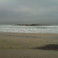 Photo taken at 76th Street Beach by Alex on 4/24/2013