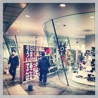 Photo taken at COMME des GARÇONS 青山店 by Akihiro Y. on 12/12/2012