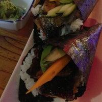 Photo taken at Sushi Saurus by Mariana S. on 2/19/2013