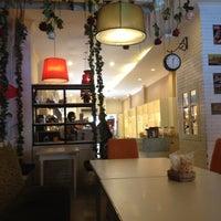 Photo taken at DE CAFÉ Resto & Delicatessen by Pingkan S. on 4/29/2013