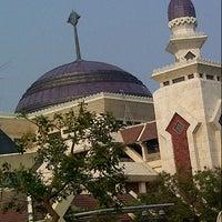 Photo taken at Masjid Agung At-Tin by eris aa'Oteks on 10/26/2012