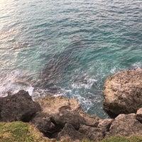 Photo taken at Tegal Wangi Beach by Ульяна М. on 2/21/2017