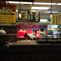 Photo taken at Portillo's Hot Dogs by Joe M. on 2/16/2013