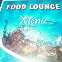 Photo taken at Food Lounge by Pius K. on 9/30/2013