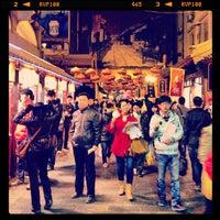 Photo taken at 王府井小吃街 Wangfujing Food Alley by Marie-Josée L. on 4/2/2013