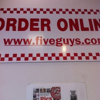 Photo taken at Five Guys by Elliott L. on 4/30/2013