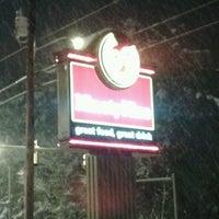 Photo taken at Ninety Nine Restaurant by Ryan C. on 2/24/2013