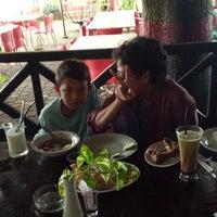 Photo taken at Restoran Pringsewu by Rita M. on 7/23/2014