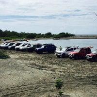 Photo taken at Playa el Derrumbao by Eduardo R. on 12/14/2014