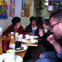 Photo taken at Table Grace Cafe by Nathan D. on 1/28/2014