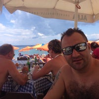 Photo taken at The Quick Corner Beach Restaurant by Mahmut A. on 6/1/2014