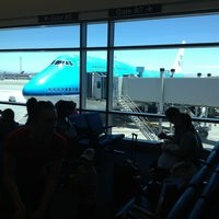 Photo taken at Gate A7 by Oleg F. on 6/28/2013