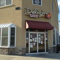 Photo taken at Delizia Pizza by Michael C. on 3/29/2013