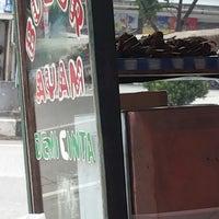 Photo taken at Jalan Margonda Raya by Lau T. on 2/14/2014