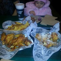 Photo taken at Wingstop by Angel J. on 1/26/2014