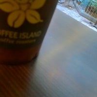 Photo taken at Coffee Island by Johnny V. on 3/7/2014