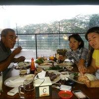 Photo taken at Telaga Seafood Restaurant by Genoveva I. on 2/13/2014