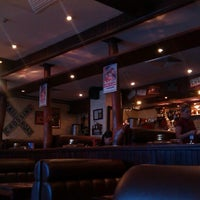 Photo taken at American Bar & Grill by Mikhail Y. on 3/1/2013