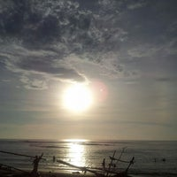 Photo taken at Tanjung Setia Surf Beach by Andy W. on 3/27/2013